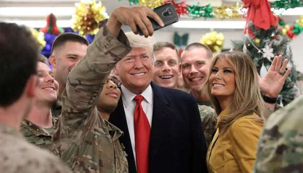 US President Trump and the First Lady greet military personnel at the dining facility during an unan