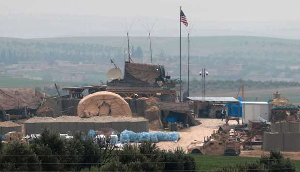 Vehicles and structures of the US-backed coalition forces are seen on the outskirts of the northern