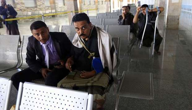 Wounded Yemeni rebels await their evacuation to the Omani capital Muscat at the Sanaa International