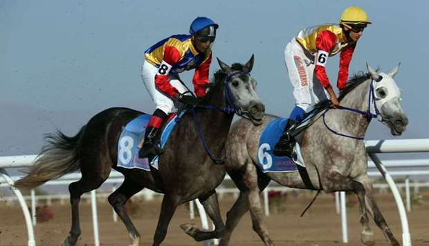 Omani jockeys take part in the race