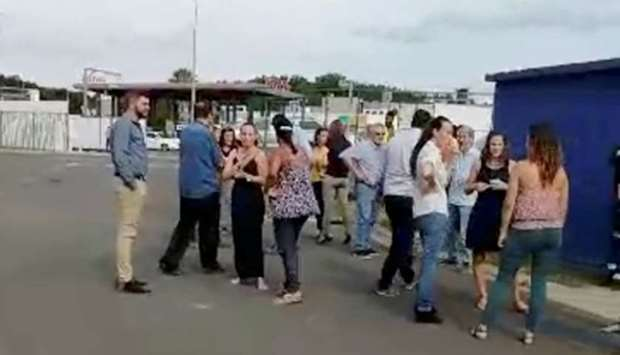 People gather outside during a quake evacuation in Noumea, New Caledonia