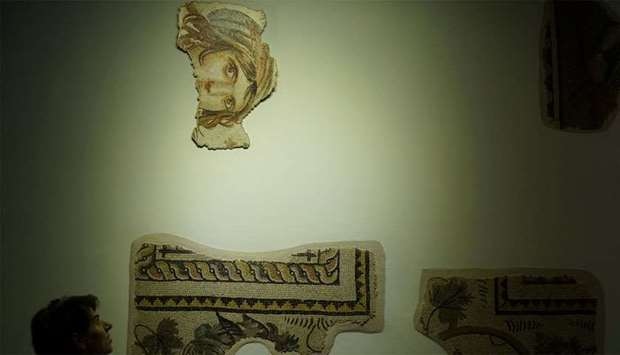 """Visitors tour the museum where the missing pieces of the historic """"Gypsy Girl"""" mosaic are on display"""