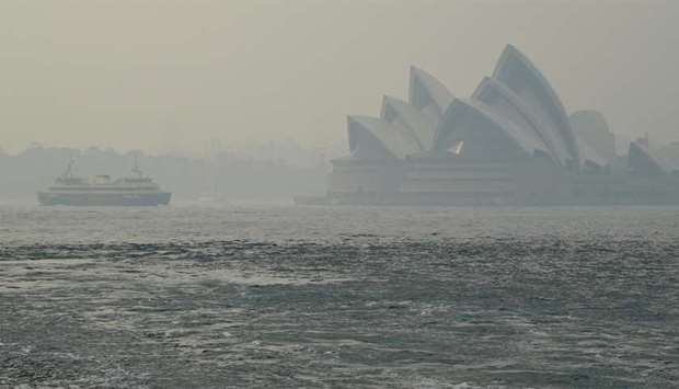 The Sydney Opera House can be seen as smoke haze from bushfires in New South Wales blankets the CBD