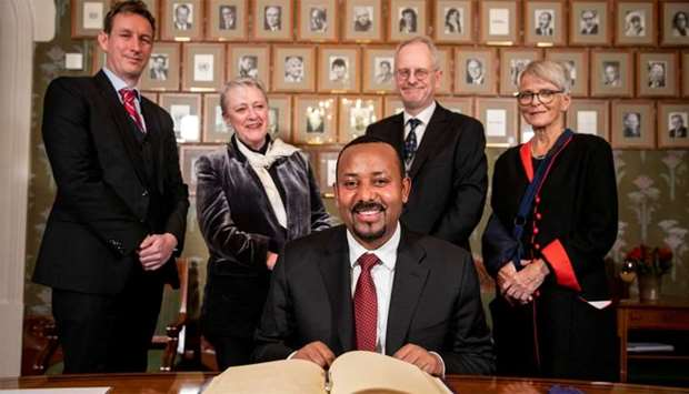 2019 Nobel Peace Prize laureate, Ethiopia's Prime Minister Abiy Ahmed poses with Nobel committee mem