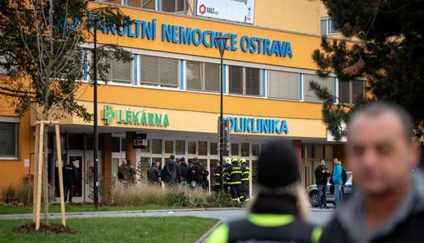 Police officers stand guard near the site of a shooting in front of a hospital in Ostrava, Czech Rep
