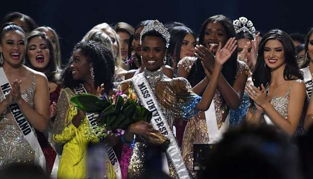 Newly-crowned Miss Universe 2019, Zozibini Tunzi of South Africa, waves from stage after the 2019 Mi