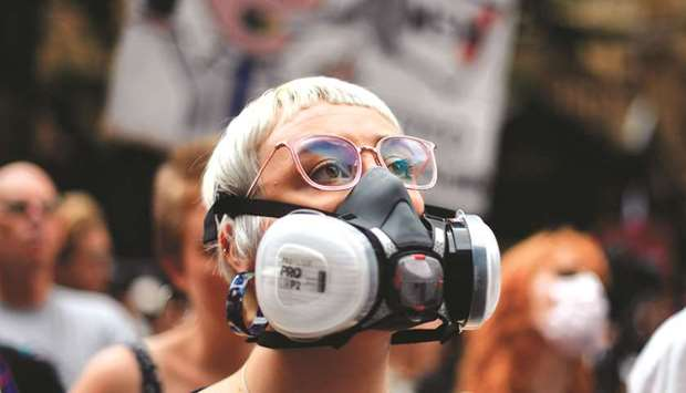 A demonstrator with a gas mask attends a protest rally in Sydney.