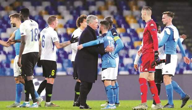 Napoli coach Carlo Ancelotti celebrates with his team after defeating Genk in their Champions League