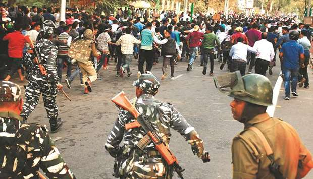 Security personnel disperse students protesting against the governments Citizenship Amendment Bill,
