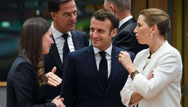 (From L) Finland's Prime Minister Sanna Marin, France's President Emmanuel Macron and Denmark's Prim