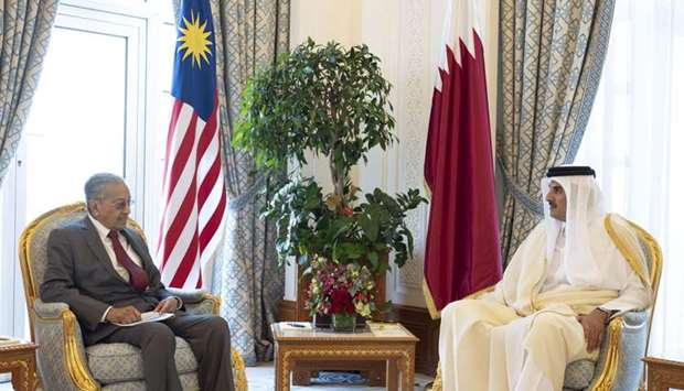 His Highness the Amir Sheikh Tamim bin Hamad al-Thani and Malaysian Prime Minister Dr Mahathir Moham
