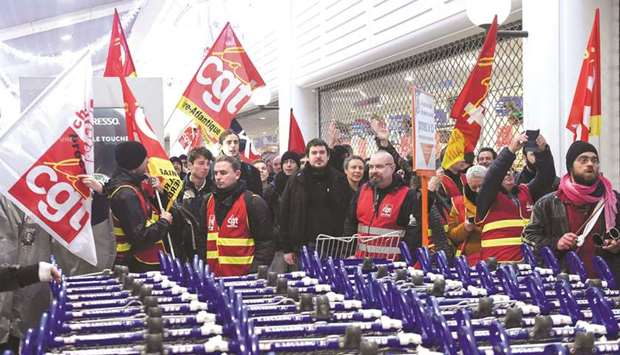 People demonstrate in the Atlantis shopping mall in Saint-Herblain, near Nantes, western France, to
