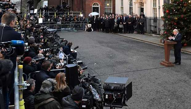 Britain's Prime Minister Boris Johnson delivers a speech outside 10 Downing Street in central London