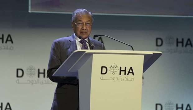 Dr. Mahathir Mohamad, the Prime Minister of Malaysia, addressing the opening session of the Doha For