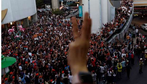 Supporters react at a sudden unauthorised rally by the progressive Future Forward Party in Bangkok,