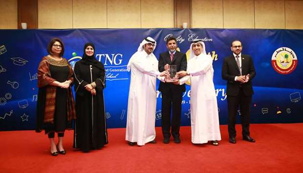 Ammar al-Mashhadani, Head of Public Relations Department, receiving the award on behalf of Qatar Can