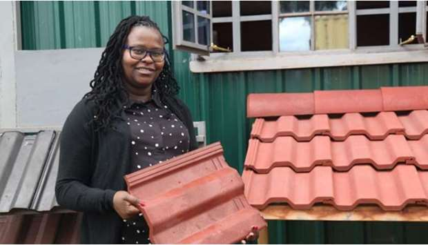 Hope Mwanake, co-founder of Eco Blocks and Tiles, poses for a photo at her factory in Gilgil, Kenya.