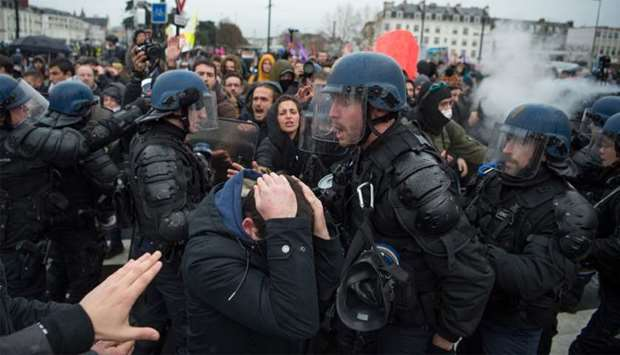 People take part in a demonstration in Nantes to protest against the French government's plan to ove