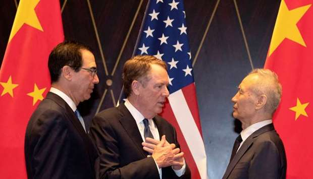 United States Trade Representative Robert Lighthizer gestures as he chats with Chinese Vice Premier