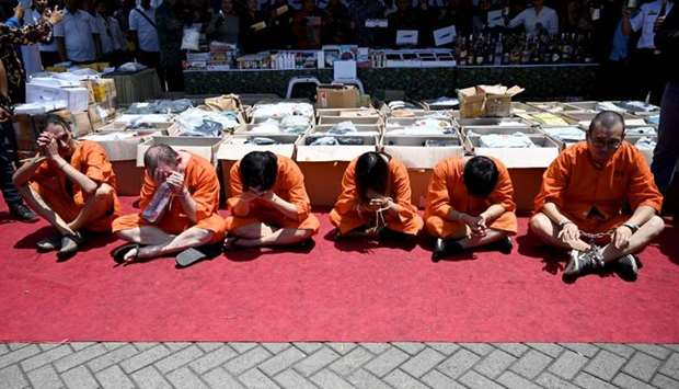 Accused drug smugglers from Hong Kong, Singapore, Thailand, Chile and Switzerland attend a press con