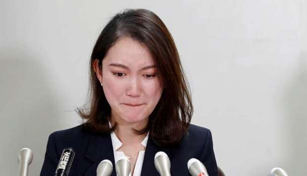 Japanese freelance journalist Shiori Ito reacts during her news conference after a court verdict in