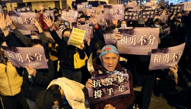 Hong Kong protesters gather outside a detention center in Lai Chi Kok to demand the release of prote