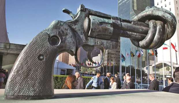 People walk past a sculpture outside the UN headquarters in New York.