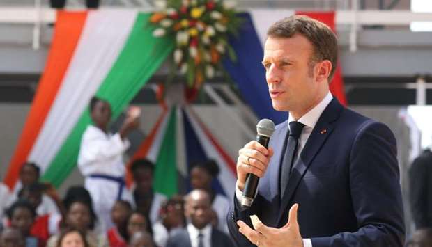 """French President Emmanuel Macron delivers a speech during the inauguration of the """"WinWin"""" Agora-Kou"""