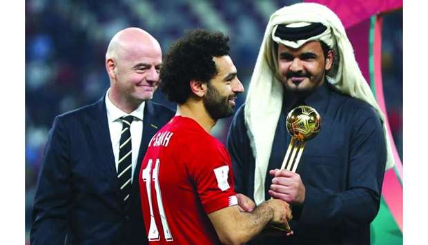 HE Sheikh Joaan bin Hamad al-Thani gives the Golden Ball award to Liverpool's Mohamed Salah as FIFA