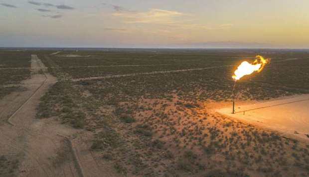 A gas flare burns at dusk in the Permian Basin in Texas (file). Opec members believe relentless US o