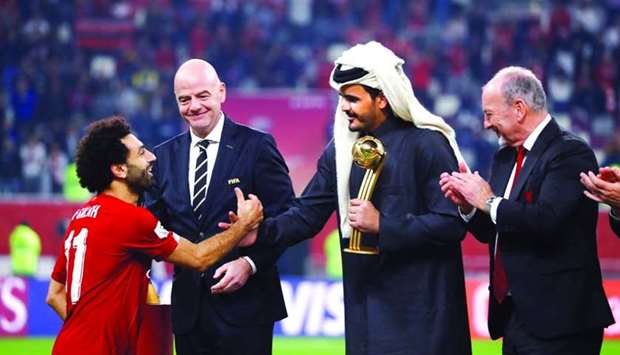 Liverpool's Mohamed Salah is presented the Golden Ball award by Qatar Olympic Committee president HE