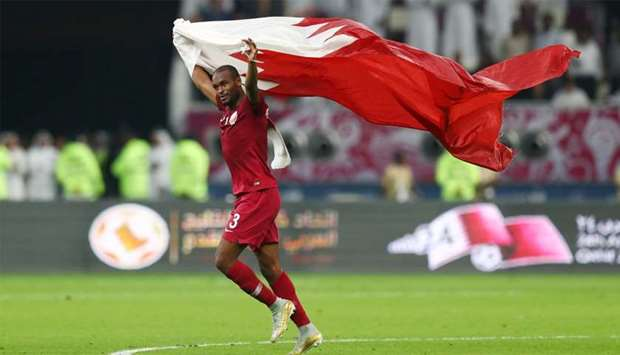 Qatar's Abdelkarim Hassan celebrates after the match