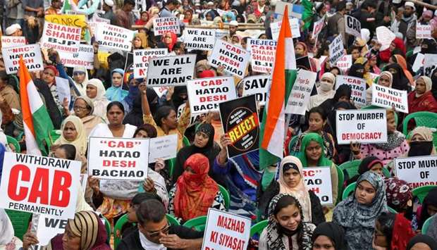 Women display placards during a protest against a new citizenship law, in Kolkata