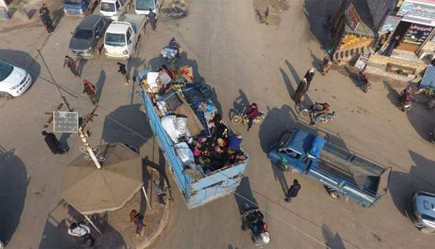 An aerial photo shows Syrian families fleeing the village of Hazano, about 20 kilometres northwest o
