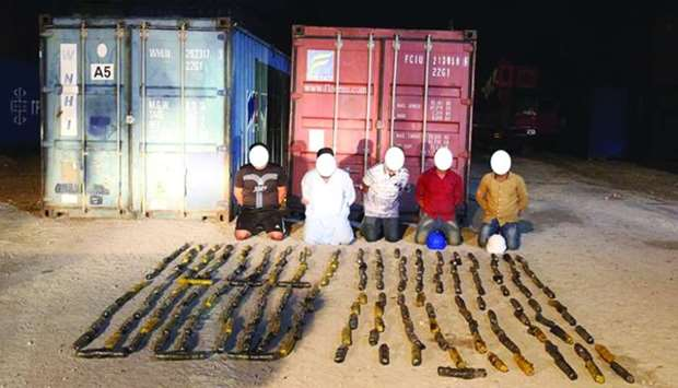 The arrested persons with the seized consignment of hashish.