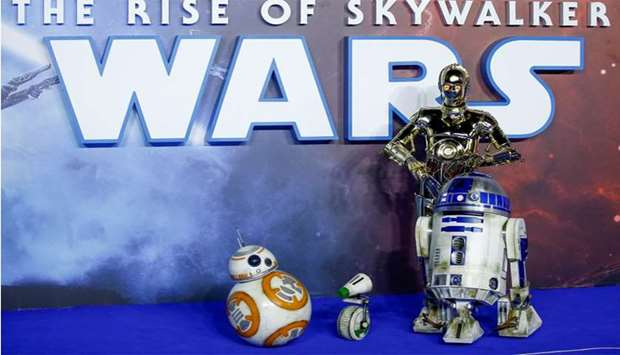 """Star Wars robots R2-D2 and BB8 and droids C3P0 and D-0 pose as they attend the premiere of """"Star War"""