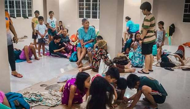 Residents rest in an evacuation centre, as typhoon Phanfone makes landfall, in Borongan, Eastern Sam