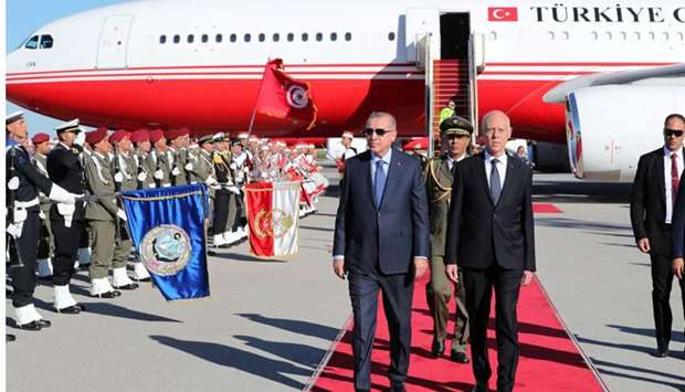 Turkey's President Tayyip Erdogan is welcomed by Tunisia's President Kais Saied at the airport in Tu