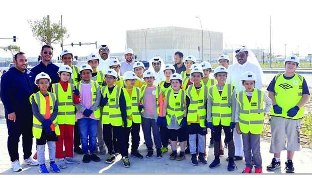Students from Al Aziziya Youth Centre during tree planting at 'Roads Surrounding Al Rayyan Stadium D