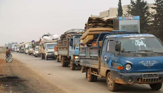 Trucks carry belongings of people fleeing from Maarat al-Numan, in northern Idlib, Syria on December