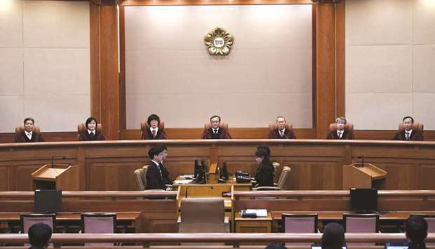 South Korea's Constitutional Court chief judge Yoo Nam-seok and other judges sit for the ruling on c