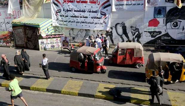 Iraqi protesters gather at Baghdad's Tahrir Square as demonstrations against the political system co
