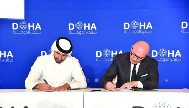 Sheikh Ali Alwaleed al-Thani (left) signing the agreement with Sahnek in Doha recently.