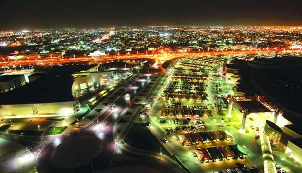 The Al Waab district is seen illuminated at night on the city skyline in Doha (file)