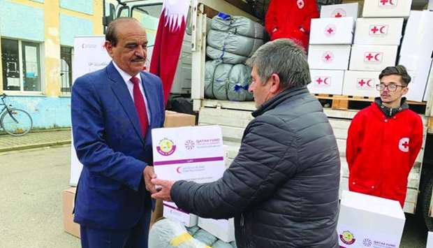 Qatar's ambassador to Albania, Ali bin Hamad al-Marri, leads distribution of relief materials