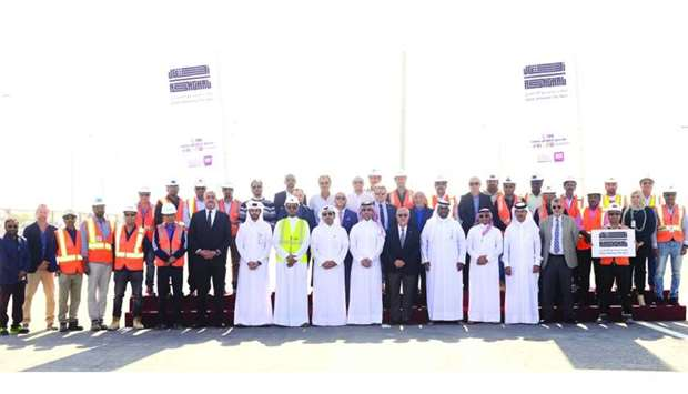 Ashghal officials and contracting company engineers attending the opening of carriageway of East Ind