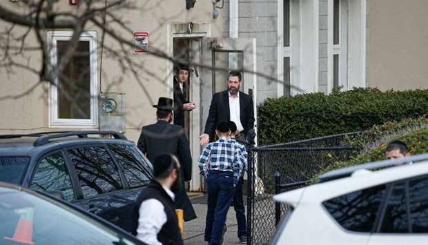 Members of the Jewish community leave from a synagoge next to the home of rabbi, Chaim Rottenbergin