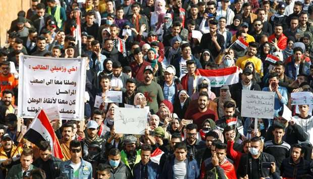 Iraqi University students gather during ongoing anti-government protests in Baghdad, Iraq