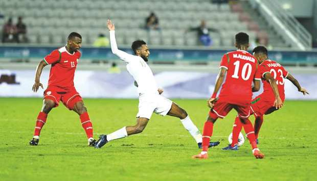 Saudi Arabia's Feras Albrikan (second from left) in action during the 24th Arabian Gulf Cup match ag