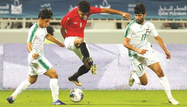 Action from the 24th Arabian Gulf Cup match between Iraq (in white) and Yemen (in red and white) yes
